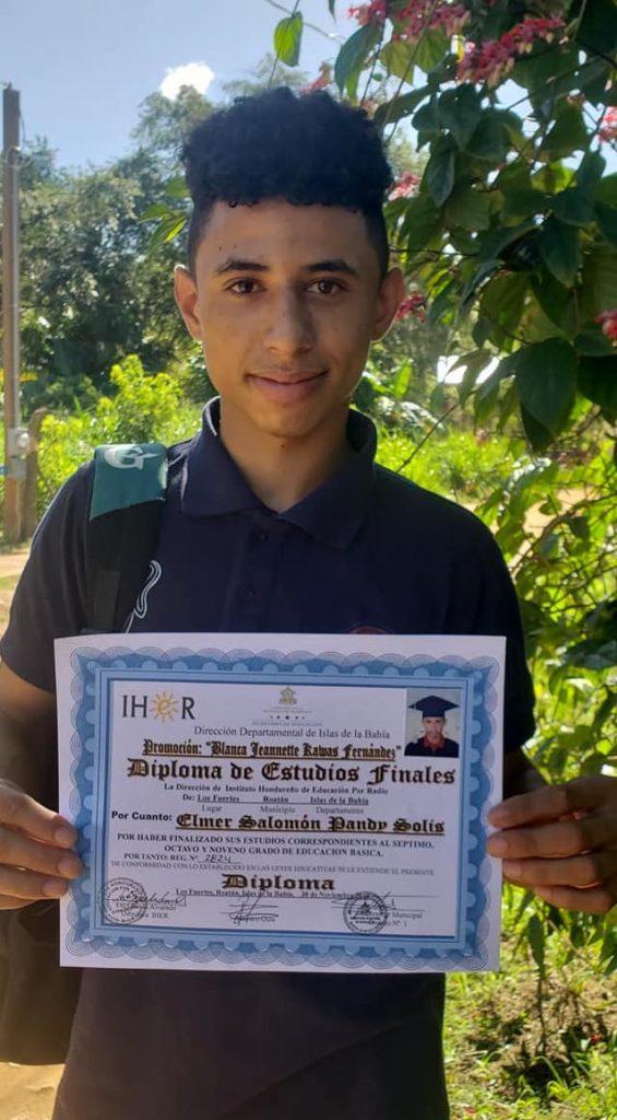 Teenage boy shows his diploma