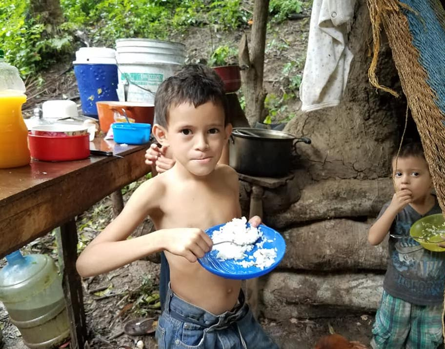 Young boy eating rice